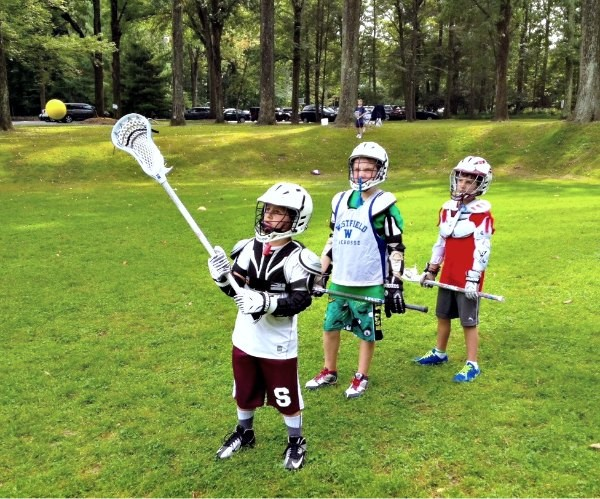 Boys learning catching at Sum It Up Lacrosse's fall clinic