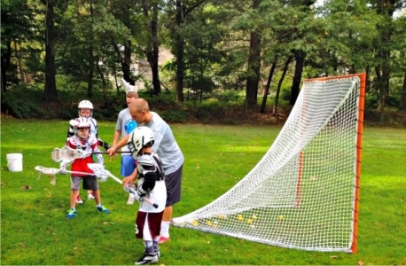 Boys practicing crease defense at Sum It Up Lacrosse's fall clinic