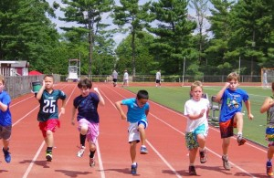 Boy campers racing on track