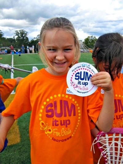 Girl holding Player of the Day sticker