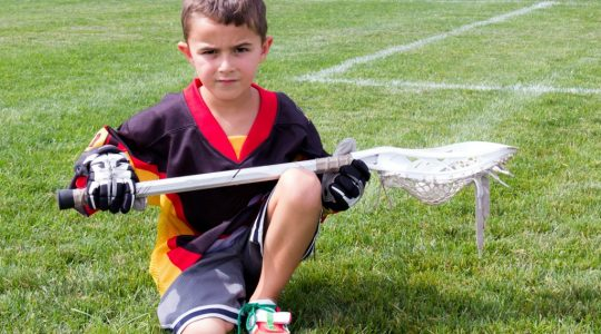 Allow young athletes to fail - here's a boy looking defeated, but it's a good opportunity to learn lacrosse and failure